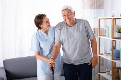 caregiver taking care of senior man at home