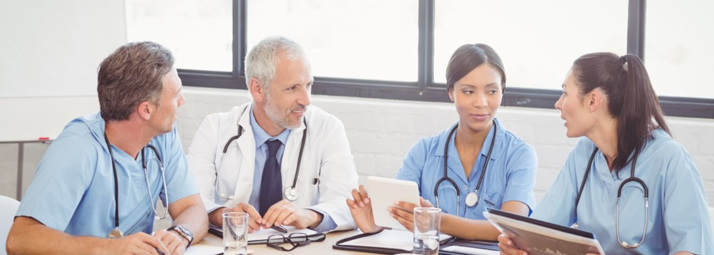 group of medical professionals talking